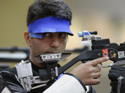 ndia`s Abhinav Bindra shoots during qualifiers for the men`s 10-meter air rifle event at the 2012 Summer Olympics, Monday, July 30, 2012, in London.