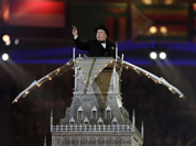 An artist imitating Winston Churchill performs during the Closing Ceremony at the 2012 Summer Olympics, Sunday, Aug. 12, 2012, in London.