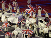 Performers wave the British Flag during the Closing Ceremony at the 2012 Summer Olympics, Sunday, Aug. 12, 2012, in London