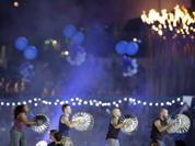 Percussion group Stomp performs during the Closing Ceremony at the 2012 Summer Olympics, Sunday, Aug. 12, 2012, in London.