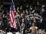 Fencer Mariel Zagunis leads Team USA into the stadium during the Opening Ceremony for the 2012 Olympic Summer Games in London.