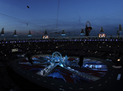 Fans take pictures in the Olympic Stadium before the start of the Closing Ceremony at the 2012 Summer Olympics, Sunday.