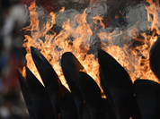 The Olympic flame burns in the Olympic Stadium before the start of the Closing Ceremony at the 2012 Summer Olympics, Sunday