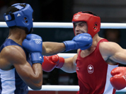 Canada`s Simon Kean, right, fights France`s Tony Yoka, during their men`s super heavyweight over 91-kg boxing match at the 2012 Summer Olympics, in London.