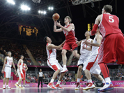 Russia`s Andrei Kirilenko (15) shoots between China`s Wang Zhizhi, left, and China`s Yi Jianlian, right, during the first half of a preliminary en`s basketball game at the 2012 Summer Olympics in London