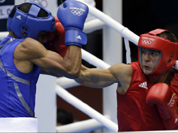 Sweden`s Anthony Yigit, right, fights Puerto Rico`s Francisco Vargas Ramirez during a light welterweight 64-kg preliminary boxing match at the 2012 Summer Olympics in London