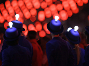 Light bulbs glow on the heads of performers during the Closing Ceremony at the 2012 Summer Olympics, Sunday, Aug. 12, 2012, in London