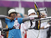 Deepika Kumari shoots next to Mexico`s Aida Roman during an individual ranking round at the 2012 Summer Olympics in London.