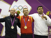 Gold medalist Alin George Moldoveanu of Romania poses with silver medalist Italy`s Niccolo Campriani and bronze medalist India`s Gagan Narang, during the victory ceremony for the men`s 10-meter air rifle at the 2012 Summer Olympics in London.