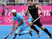 Sandeep Singh controls the ball against New Zealand during their men`s hockey preliminary round match at the 2012 Summer Olympics.