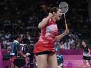 India`s Jwala Gutta jumps up after winning against Taiwan`s Cheng Wen-hsing and Chien Yu-chin, unseen, at a women`s doubles badminton match of the 2012 Summer Olympics.