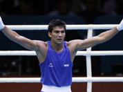 India`s Kumar Manoj reacts after defeating Turkmenistan`s Serdar Hudayberdiyev in a light welter 64-kg boxing match at the 2012 Summer Olympics in London.