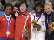 Silver medalist Acosta Bermoy, of Cuba, from left, gold medalist An Kum Ae, of North Korea and bronze medalists Priscilla Gneto, of France and Rosalba Forciniti, of Italy, share the podium after the women`s 52-kg judo competition at the 2012 Summer Olympics.