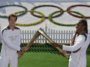 Scottish tennis player Andy Murray, hands over the Olympic flame to US tennis player Venus Williams at the All England Tennis Club in Wimbledon, ahead of the 2012 Summer Olympics.