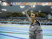 United States` Michael Phelps poses with his gold medal for the men`s 4x200-meter freestyle relay swimming final at the Aquatics Centre in the Olympic Park during the 2012 Summer Olympics in London