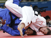 Luxembourg`s Marie Muller, right, competes with Mauritius`s Christianne Legentil during the women`s 52-kg judo competition at the 2012 Summer Olympics in London