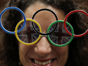 Dana Kerstein wears glasses with the Olympic rings as she attends the archery competition at the 2012 Summer Olympics in London