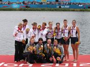 Winners of the women`s rowing quadruple sculls final pose with their medals in Eton Dorney, near Windsor, England, at the 2012 Summer Olympics. Gold medal winners from the Ukraine are at bottom, silver medal winners from Germany at left, and bronze medal winners from the U.S