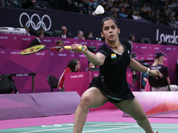 India`s Saina Nehwal plays against Belgium`s Lianne Tan, unseen, at a woman`s singles badminton match of the 2012 Summer Olympics