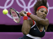 Serena Williams of the United States returns to Vera Zvonareva of Russia at the All England Lawn Tennis Club in Wimbledon, London at the 2012 Summer Olympics.