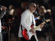 The Who guitarist Pete Townsend, right, and singer Roger Daltrey perform during the Closing Ceremony at the 2012 Summer Olympics, Monday, Aug. 13, 2012, in London.