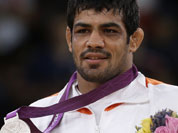 Sushil Kumar of India reacts during the victory ceremony after winning the silver medal in 66-kg freestyle wrestling at the 2012 Summer Olympics.
