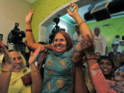 Kamla Devi, center, the mother of Indian wrestler Sushil Kumar celebrate after her son won the silver medal at the Olympic games in London, at the family home in New Delhi.