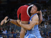Sushil Kumar of India competes with Tatsuhiro Yonemitsu of Japan (in blue) during their 66-kg freestyle wrestling gold medal match at the 2012 Summer Olympics.