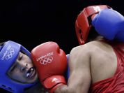 Kazakhstan`s Danabek Suzhanov fights India`s Vijender, right, during a middle weight 75-kg preliminary boxing match at the 2012 Summer Olympics.
