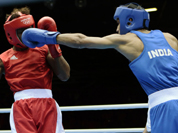 India`s Bhagwan Jai, right, connects with Andrique Allisop of the Seychelles, during men`s light 60-kg boxing at the 2012 Summer Olympics.