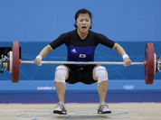 North Korea`s Yun Choi Om lifts during the men`s 56-kg, group B, weightlifting competition at the 2012 Summer Olympics in London.
