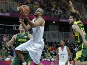 France`s Tony Parker drives to the basket past Lithuania`s Simas Jasaitis during a men`s basketball game at the 2012 Summer Olympics.