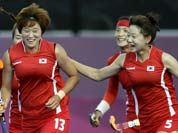 South Korean players celebrate a goal by Cheon Seul-ki (13) during their women`s hockey preliminary match against Japan at the 2012 Summer Olympics.