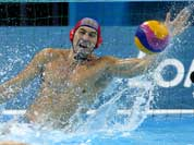 Nikolay Maximov of Kazakhstan makes a save on a shot by Greece during a preliminary men`s water polo match at the 2012 Summer Olympics.