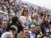 Ann Romney, left, the wife of U.S. Republican presidential candidate Mitt Romney applauses after her co-owned horse Rafalca attends in the equestrian dressage competition, at the 2012 Summer Olympics.