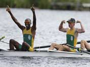 South Africa`s, from left, Sizwe Ndlovu, John Smith, Mathew Brittain and James Thompson celebrate after winning the gold medal for the lightweight men`s rowing four in Eton Dorney, near Windsor, England, at the 2012 Summer Olympics.