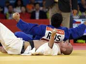Czech Republic`s Lukas Krpalek, in white, competes against Russia`s Tagir Khaibulaev during the men`s 100-kg judo competition at the 2012 Summer Olympics.