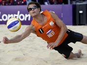 Reinder Nummerdor of the Netherlands goes for a dig during a 2 set loss to Latvia during a beach volleyball match at the 2012 Summer Olympics.