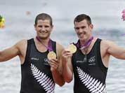New Zealand`s Joseph Sullivan, right, and Nathan Cohen celebrate after winning the gold medal for the men`s rowing double sculls in Eton Dorney, near Windsor, England, at the 2012 Summer Olympics.