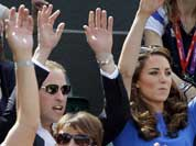 Prince William and Kate, Duchess of Cambridge, join the crowd in doing the wave at a match between Andy Murray of Great Britain and Nicolas Almagro of Spain at the All England Lawn Tennis Club at Wimbledon, in London.