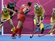 United States` Rachel Dawson (8) attempts to score against Australia during their women`s hockey preliminary match against the United States at the 2012 Summer Olympics.