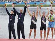 Italy`s Romano Battisti and Alessio Sartori , New Zealand`s Joseph Sullivan and Nathan Cohen and Slovenia`s Iztok Cop and Luka Spik and Iztok Cop celebrate with the medals they won for the men`s rowing double sculls in Eton Dorney, near Windsor, England.