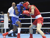 China`s Liu Qiang, right, fights Cuba`s Yashier Toledo Lopez during their men`s light 60-kg boxing match at the 2012 Summer Olympics.