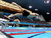 United States` Michael Phelps dives off the starting blocks in the men`s 100-meter butterfly swimming race at the 2012 Summer Olympics.