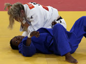 Gemma Gibbons of Great Britain reacts after winning her match against Audrey Tcheumeo of France during the women`s 78-kg judo competition at the 2012 Summer Olympics.