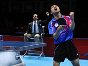 Chuang Chih-yuan of Taiwan, reacts against Dimitrij Ovtcharov of Germany, during the bronze medal match at men`s singles table tennis at the 2012 Summer Olympics.