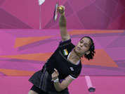 Saina Nehwal plays against Denmark`s Tine Baun, unseen, at a women`s singles badminton quarterfinal match of the 2012 Summer Olympics.