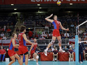 Russia`s Dmitriy Muserskiy (13) goes up for a spike against the Tunisia defense during a men`s volleyball preliminary match at the 2012 Summer Olympics.