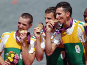 South Africa`s Sizwe Ndlovu, John Smith, Mathew Brittain and James Thompson kiss the gold medals they won for the lightweight men`s rowing four in Eton Dorney, near Windsor, England, at the 2012 Summer Olympics.