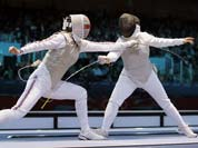 Britain`s Sophie Troiano faces Egypt`s Shaimaa Elgammal during a round of 16 match at women`s team foil fencing at the 2012 Summer Olympics.